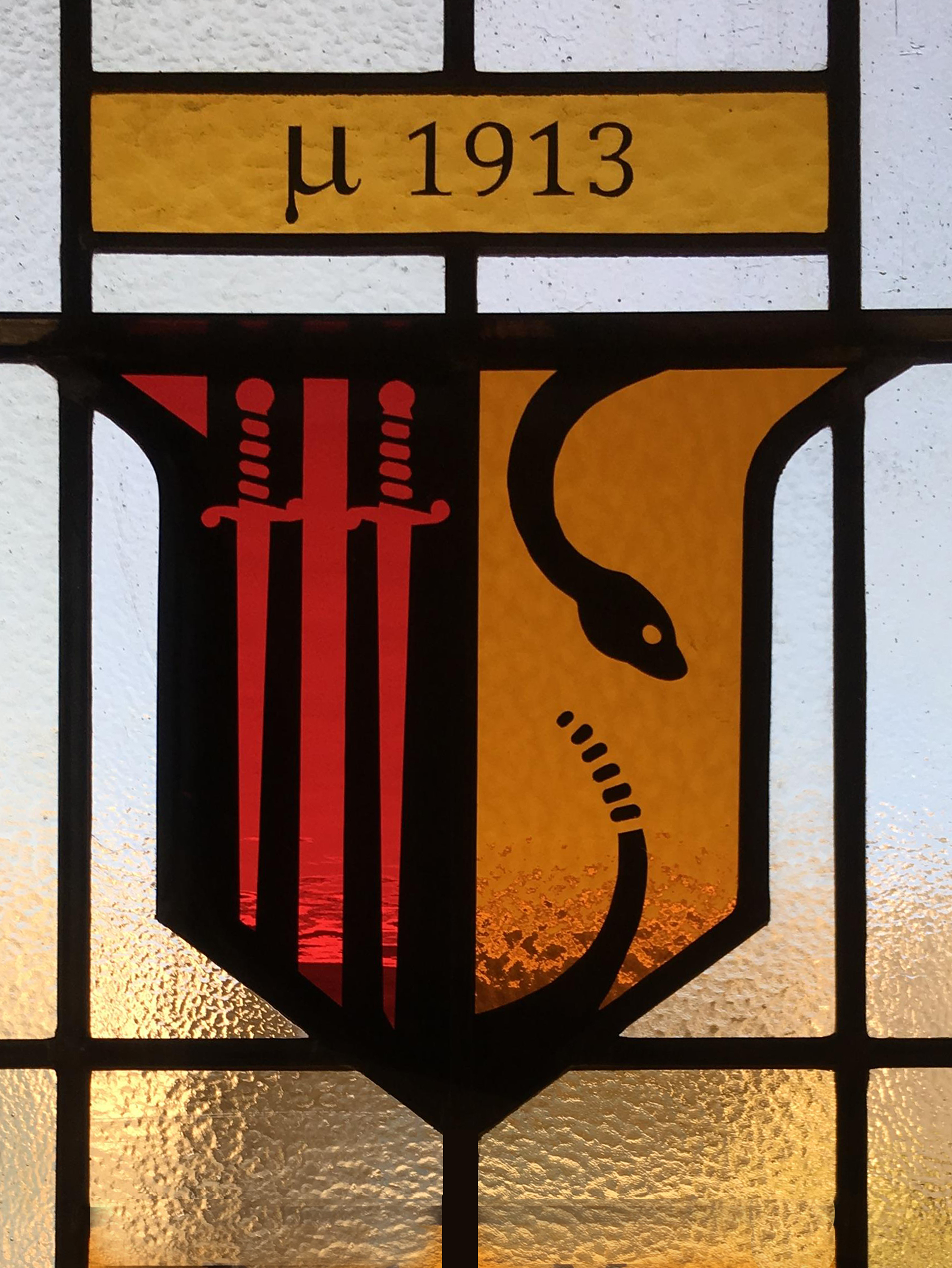 Hand painted logo for a stained glass window in Berkeley for Theta Chi Fraternity.
